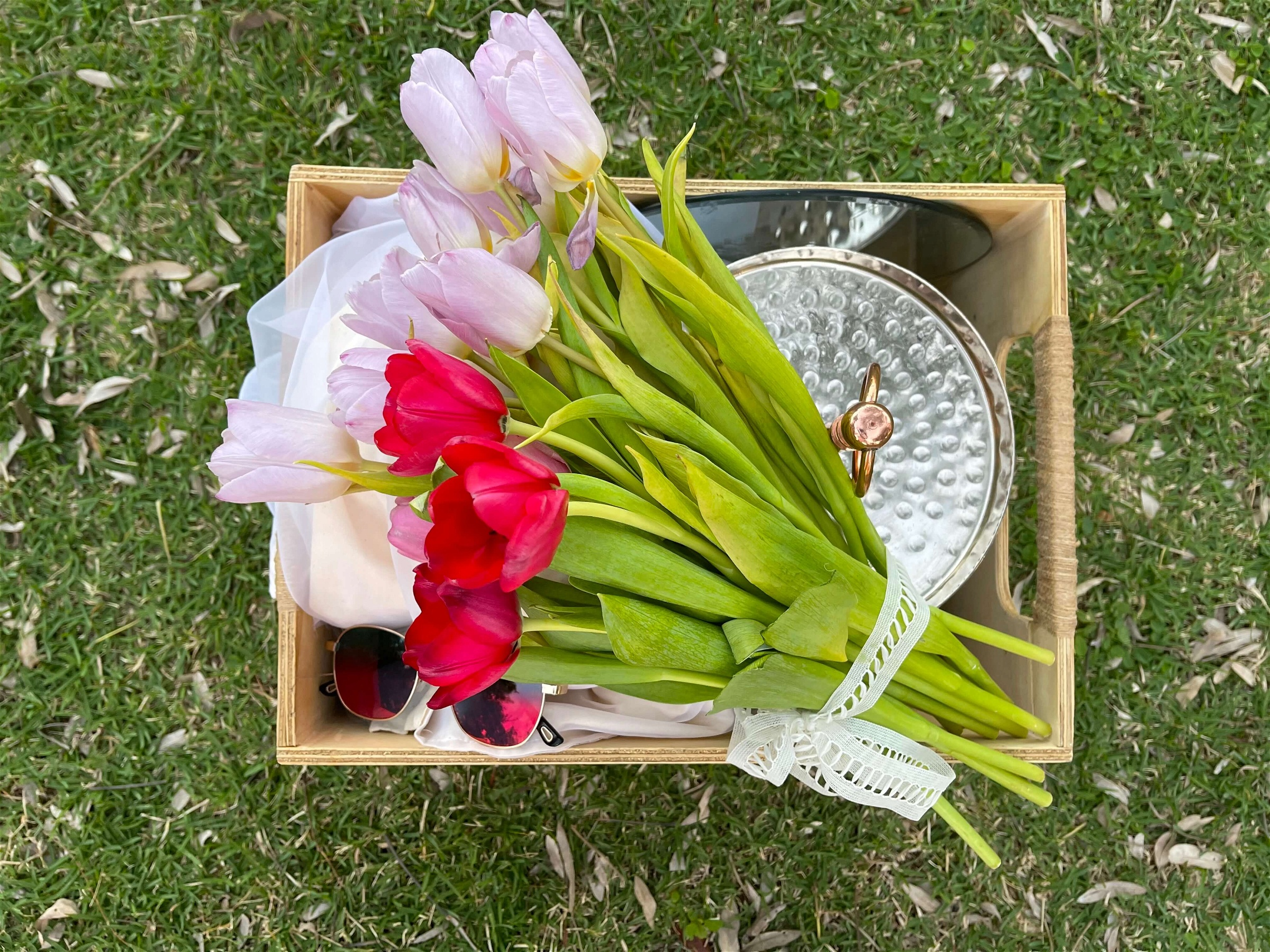 Fresh flowers in a picnic basket in Puerto Rico, designed by Lovely Picnic Hour.