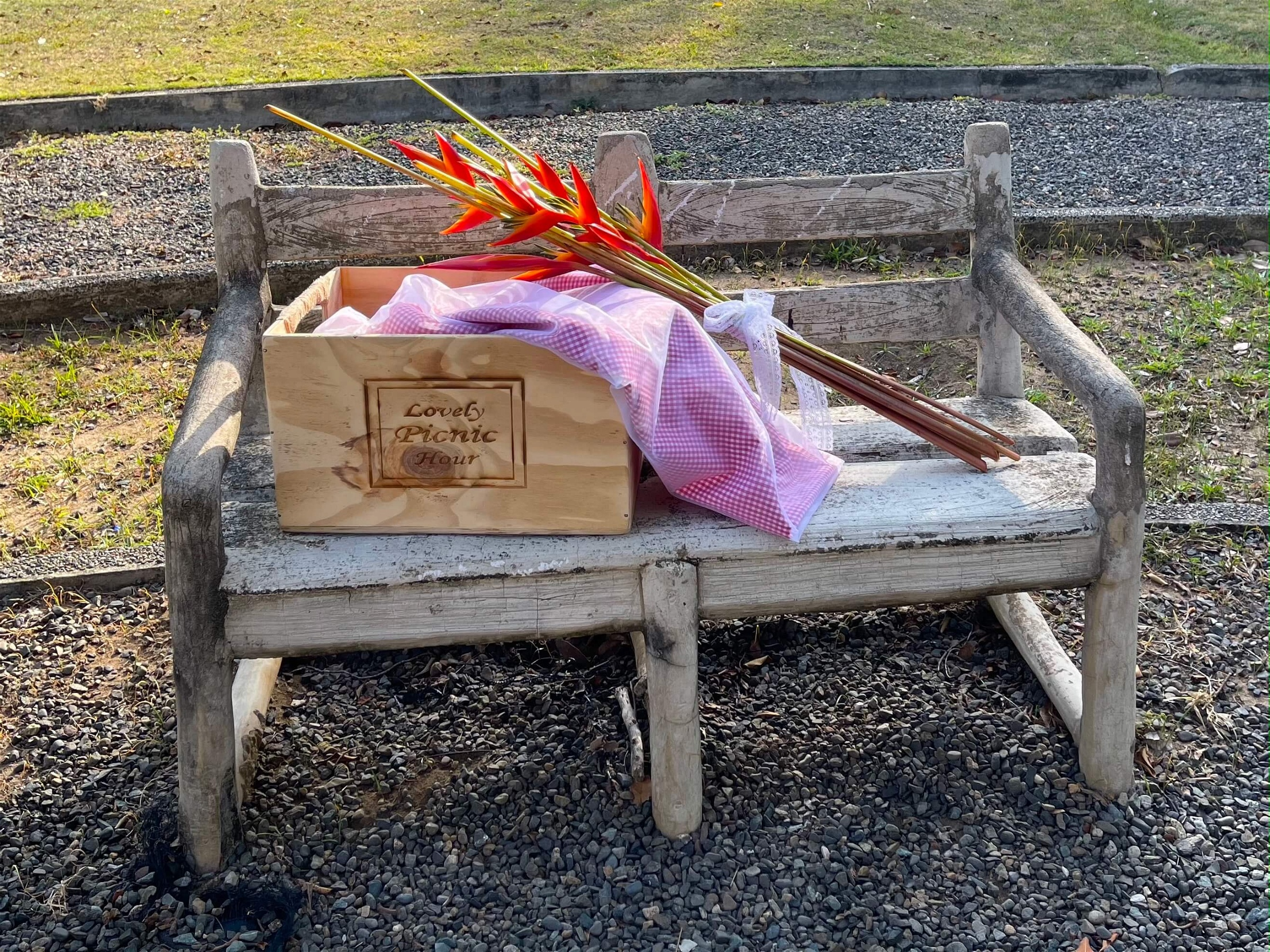 Picnic box with fresh flowers in Luis Muñoz Rivera Park in San Juan, Puerto Rico. Designed by Lovely Picnic Hour.