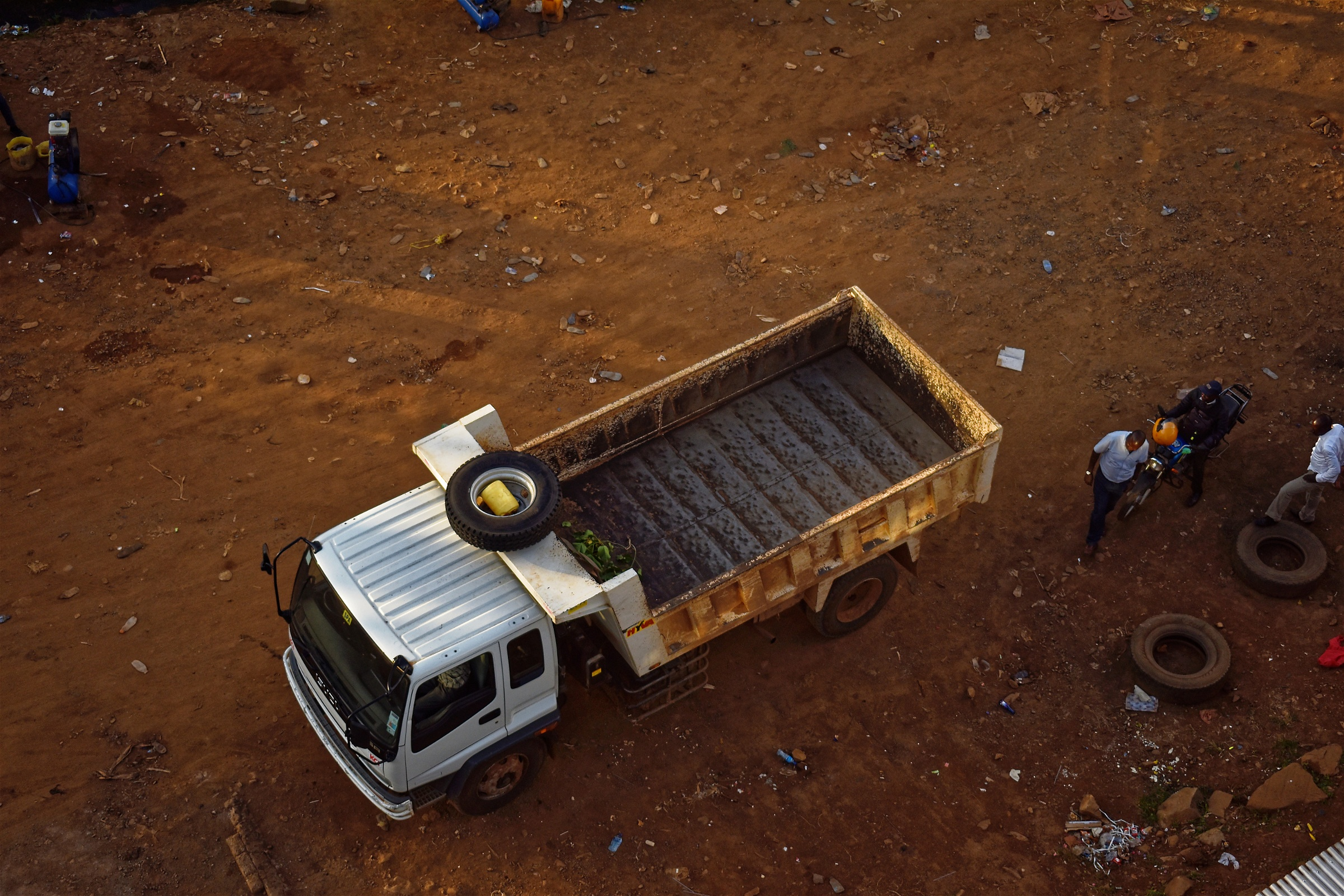 overhead view of a lorry packed on an Earthen Road