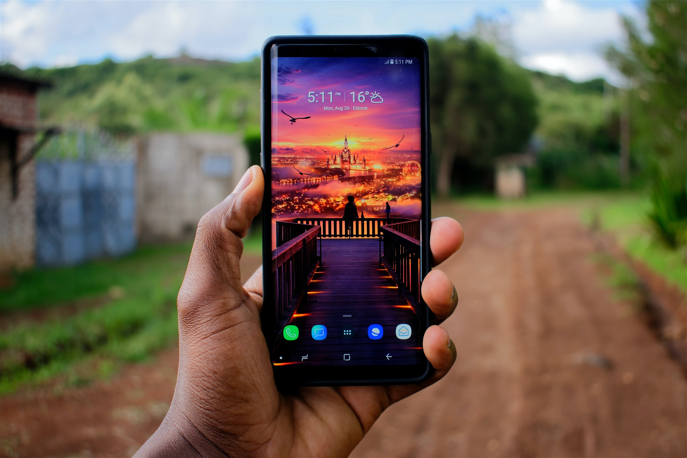 black hand holding a samsung galaxy note 9 android phone